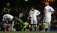 Photo: Paul Thomas.<br /> Chelsea v Wycombe Wanderers. Carling Cup, Semi Final 2nd Leg. 23/01/2007.<br /> <br /> Dejected Wycombe players (L-R) Tommy Doherty and Tommy Mooney wait while Chelsea celebrate.