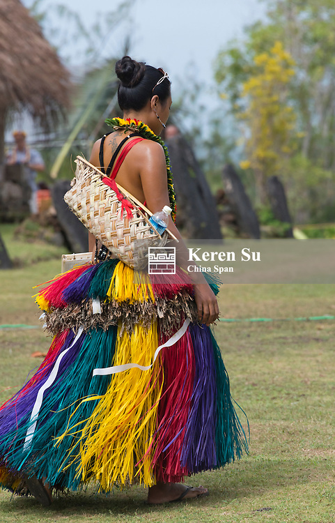 Yapese girl in traditional clothing carrying hand bag at Yap Day Festival, Yap Island, Federated States of Micronesia