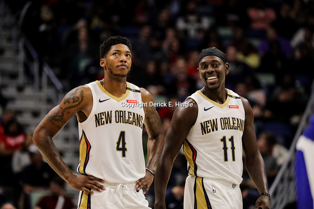 Oct 23, 2018; New Orleans, LA, USA; New Orleans Pelicans guard Jrue Holiday (11) and guard Elfrid Payton (4) during the second half against the Los Angeles Clippers at the Smoothie King Center. The Pelicans defeated the Clippers 116-109. Mandatory Credit: Derick E. Hingle-USA TODAY Sports