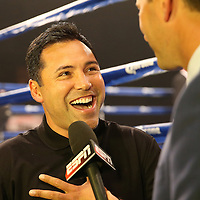 Oscar De La Hoya speaks with Teddy Atlas during the Iron Mike Productions, ESPN Friday Night Fights boxing match at Turning Stone Resort Casino on Friday, June 6, 2014 in Verona, New York.  (AP Photo/Alex Menendez)