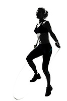 woman workout fitness posture body building jumping rope exercise exercising on studio isolated white background