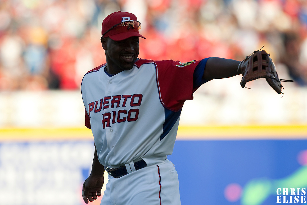 11 March 2009: #21 Carlos Delgado of Puerto Rico smiles to a teammate during the 2009 World Baseball Classic Pool D game 6 at Hiram Bithorn Stadium in San Juan, Puerto Rico. Puerto Rico wins 5-0 over the Netherlands