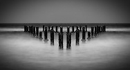 Triangle of pilings in the sea