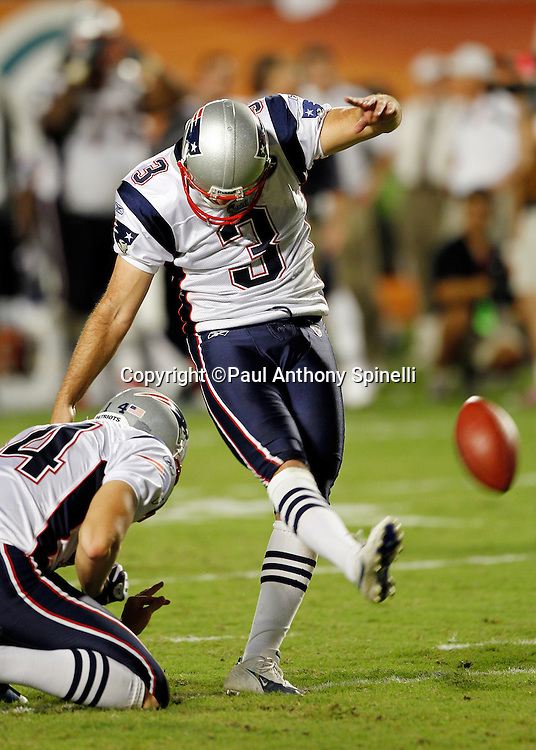 New England Patriots kicker Stephen Gostkowski (3) kicks a PAT that gives the Patriots a 21-14 third quarter lead during the NFL week 1 football game against the Miami Dolphins on Monday, September 12, 2011 in Miami Gardens, Florida. The Patriots won the game 38-24. ©Paul Anthony Spinelli