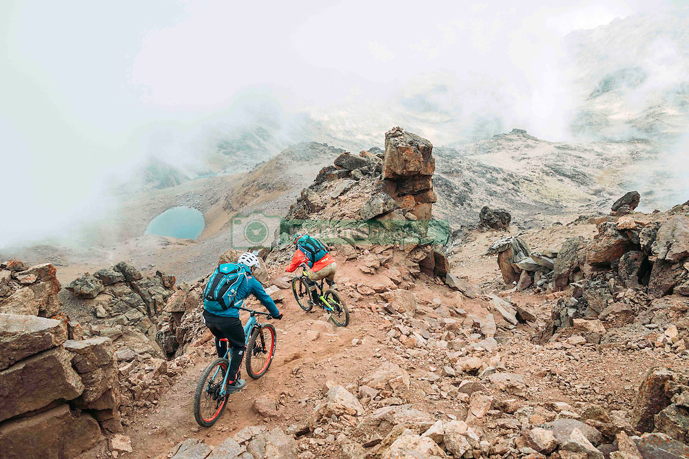 """Oct 26, 2016 - Mount Kenya, Kenya - Swiss-American HANS REY and German GERHARD CZERNER ride down from the peak of Mount Kenya. Professional mountain bike riders Hans Rey, Danny MacAskill and Gerhard Czerner are the first to take on Africa's two highest mountains back to back on mountain bikes. On Oct 26th Rey and Czerner summit Africa's second tallest mountain, Mount Kenya's Point Lenana (4,985m/16,355ft) with their mountain bikes. On November 3rd, only one week later, together with urban trials YouTube sensation Danny MacAskill; they also summited Mount Kilimanjaro (5,895m/19,340ft), the Roof of Africa. There have only been a handful of people who have taken their bikes to either Mount Kilimanjaro or Mount Kenya in the past, but none have achieved both, one straight after the other. Others carried their bikes for the majority both up and down the mountains, while Rey (Swiss/American), MacAskill (Scottish) and Czerner (German) rode 98% of the descent. They are world renown extreme bikers and their feats will be featured in a TV documentary, magazine stories and an upcoming film about the Mountain Bike Freeride history, titled """"Nothin For Free"""" produced by Freeride Entertainment. The hardest part about the trip was adjusting to the high altitude. The terrain is extremely technical and challenging, several different eco-systems are being crossed on the way, from rainforests to glaciers. It took the riders 4 days to summit and traverse Mount Kenya, and 6 days to summit and descend Mount Kilimanjaro. The National Parks plan on extending their programs to permit bike riders in the future. For those that dare, there are adventures and ultimate challenges both physically and mentally awaiting them. (Credit Image: © Martin Bissig via ZUMA Wire)"""