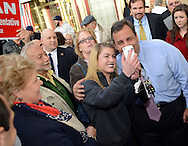 BURLINGTON CITY, NJ -  NOVEMBER 4: New Jersey Governor Chris Christie poses for photos with supporters while campaigning at Old City Quilts November 4, 2013 in Burlington City, New Jersey. Republican Governor Chris Christie faces Democratic state senator Barbara Buono in the November 5th general election. (Photo by William Thomas Cain/Cain Images)