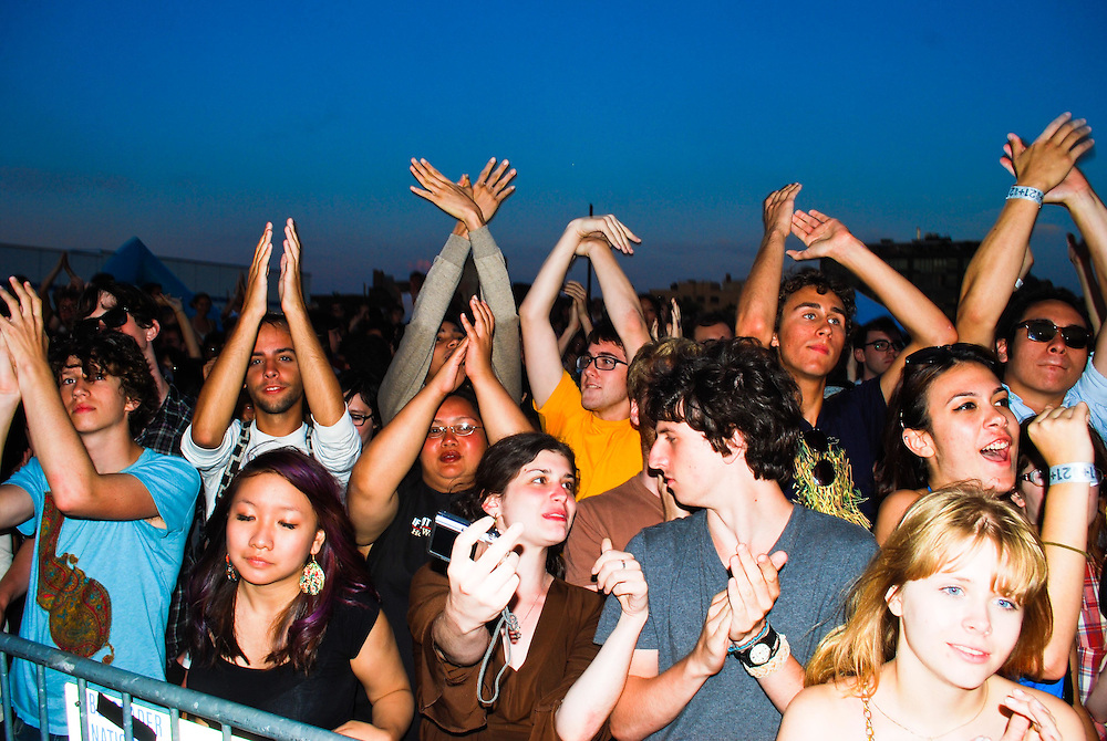 "Concert goers do ""dove hands"" during Grizzly Bear's set at the JELLY Pool Party free concert series at East River State Park, Williamsburg, Brooklyn, New York"