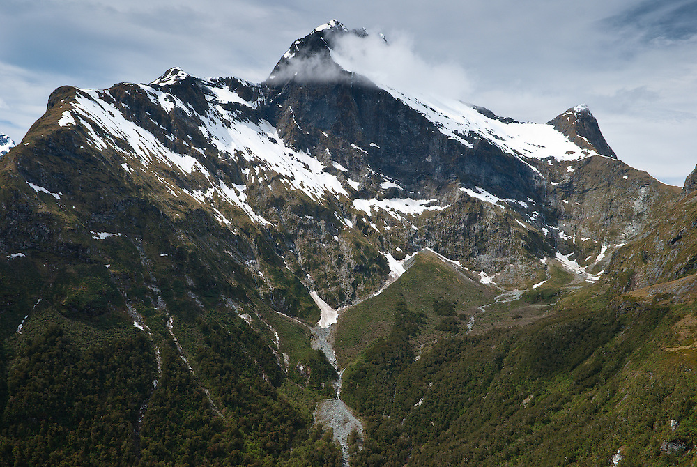 Cloud around the peak of Mount Elliot and the Jervois Glacier as seen from Mackinnon Pass, Milford Track, New Zealand