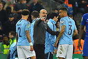 Manchester City manager Pep Guardiola talking to Danilo (3) of Manchester City at extra time half time during the Carabao Cup Final match between Chelsea and Manchester City at Wembley Stadium, London, England on 24 February 2019.