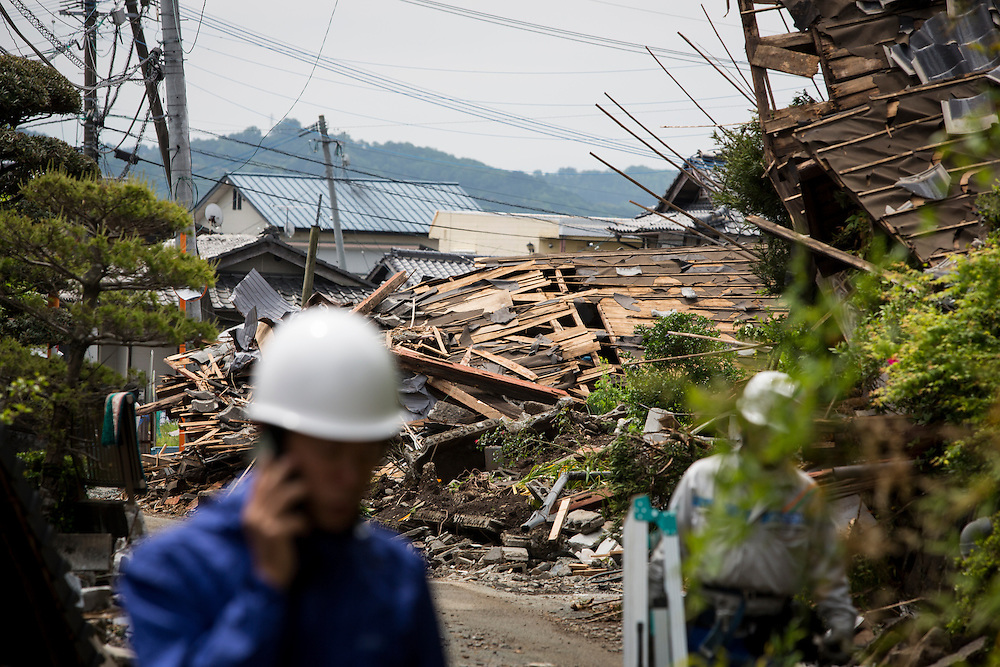 KUMAMOTO, JAPAN - APRIL 22:  A earthquake survivors is seen through the wreckage of houses on April 22, 2016 in Mashiki town, Kumamoto, Japan. To date 48 people are confirmed dead and more than 80,000 people have evacuated after an 6.5 earthquake on Thursday night and a stronger 7.3 quake on Saturday morning struck the Kyushu Island in western Japan.<br /> <br /> Photo: Richard Atrero de Guzman
