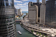 Looking down on a water taxi traveling the Chicago River by Trump Tower in Chicago, IL.