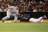 PHOENIX, AZ - MAY 28:  Chris Owings #16 of the Arizona Diamondbacks safely steals third base under Brett Wallace #39 of the San Diego Padres in the seventh inning at Chase Field on May 28, 2016 in Phoenix, Arizona.  (Photo by Jennifer Stewart/Getty Images)