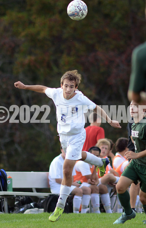 SSOUTH09<br /> Central Bucks South's Brian Davis #5 heads the ball in the first half against Pennridge Thursday October 8, 2015 at Central Bucks South in Warrington, Pennsylvania. (William Thomas Cain/For The Inquirer)