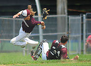 Falls third baseman Chris Mangold collides with catcher Shaughn Wright #24 while chasing down an infield hit in the 3rd inning at Neshaminy High School Sunday July 5, 2015 in Langhorne, Pennsylvania. (Photo by William Thomas Cain)