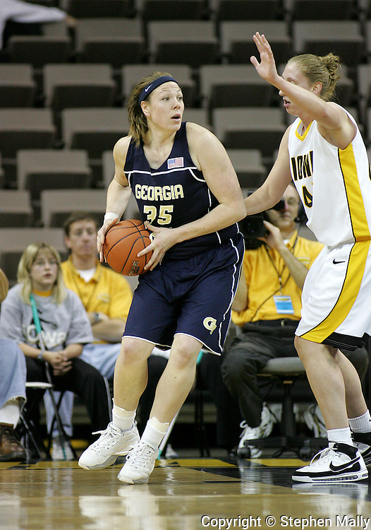28 NOVEMBER 2007: Georgia Tech forward Brigitte Ardossi (35) looks to pass the ball around Iowa center JoAnn Hamlin (45) in the first half of Georgia Tech's 76-57 win over Iowa in the Big Ten/ACC Challenge at Carver-Hawkeye Arena in Iowa City, Iowa on November 28, 2007.
