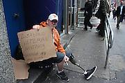 27 February 2013. New York, NY. A homeless disabled veteran sits on a doorstep on 45th St. Photograph by Sehar Mughal/CUNY Journalism Photo