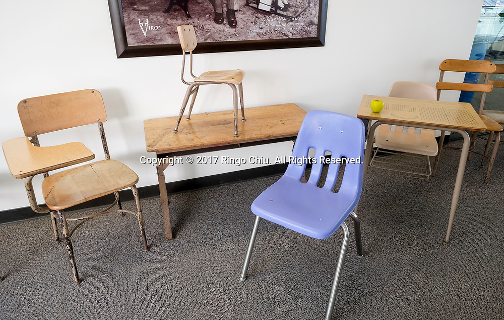 A 9000 series chair stands in front of the old furniture are displayed in the showroom of Virco. (Photo by Ringo Chiu)<br /> <br /> Usage Notes: This content is intended for editorial use only. For other uses, additional clearances may be required.