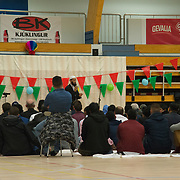 Ahmad Seddeeq, the imam of the Islamic Cultural Center of Iceland, is addressing the community of Muslims in a sports hall in Reykjavik.