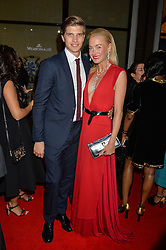 TOBY HUNTINGTON-WHITELEY and PRINCESS LILLY ZU SAYN WITTGENSTEIN BERLEBURG at the launch of the new Bulgari flagship store at 168 New Bond Street, London on 14th April 2016.