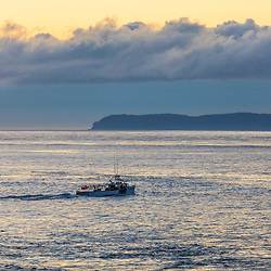 Fishing boat at dawn as seen from Quoddy Head State Park in Lubec, Maine.