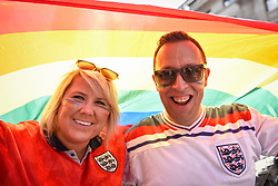 © Licensed to London News Pictures. 07/07/2018. LONDON, UK. England fan,s en route to the Olympic Park to watch the England v Sweden World Cup football match, view the annual Pride in London Parade, the largest celebration of the LGBT+ community in the UK.  Photo credit: Stephen Chung/LNP