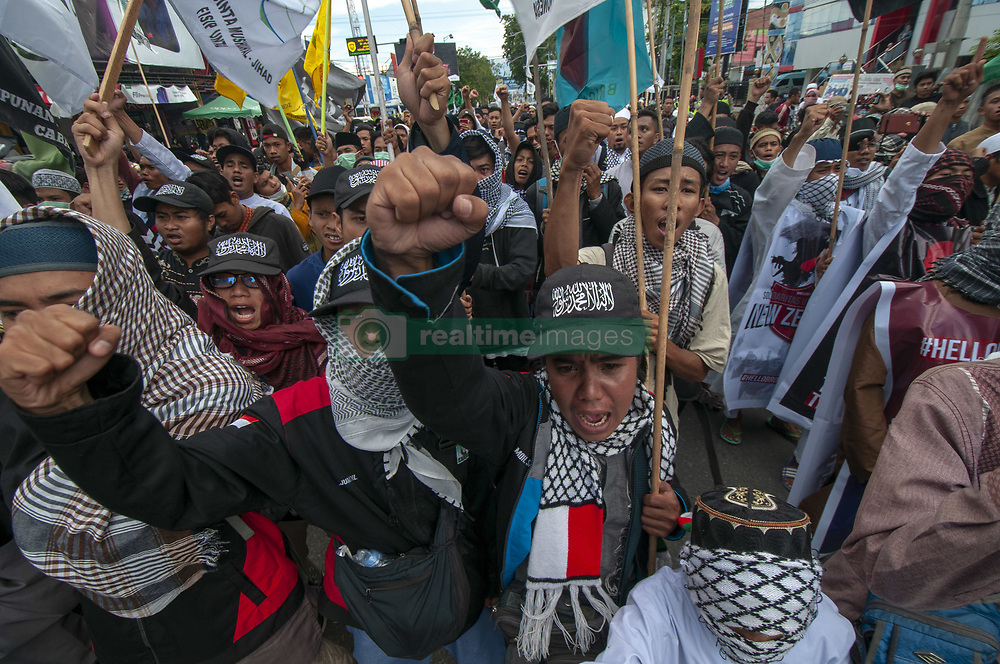 March 22, 2019 - Palu, Central Sulawesi, Indonesia - Palu, Sulawesi Tengah, Indonesia (March 22): Activists of the Central Sulawesi Islamic Forum (FUI) shouted ''Allahu Akbar'' during a demonstration in Palu, Central Sulawesi, Indonesia, Friday, March 22, 2019.  They condemned the Branton Tarrant action he called an act of terrorism who had opened fire on Muslims who were holding Friday prayers in New Zealand and left at least 49 people dead on March 15, 2019. (Credit Image: © Basri Marzuki/NurPhoto via ZUMA Press)