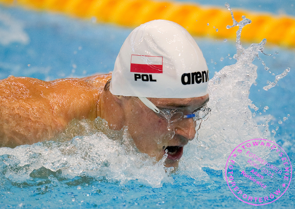 Pawel Korzeniowski of Poland competes in Men's 200m Butterfly qualification heat during European Short Course Swimming Championships Szczecin 2011 at Floating Arena in Szczecin...Poland, Szczecin, December 10, 2011..Picture also available in RAW (NEF) or TIFF format on special request...For editorial use only. Any commercial or promotional use requires permission...Photo by © Adam Nurkiewicz / Mediasport