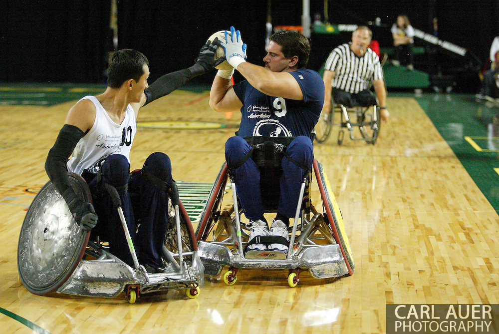 July 7th, 2006: Anchorage, AK - Scot Severn (9) tries to pass as William Groulx (10) plays tight defense as White defeated Blue in the gold medal game of Quad Rugby at the 26th National Veterans Wheelchair Games.