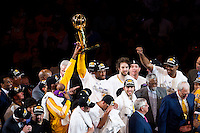 17 June 2010:  Center D.J. Mbenga of the Los Angeles Lakers holds up the Larry O'Brien trophy and celebrates with his team after the Lakers defeat the Boston Celtics 83-79 and win the NBA championship in Game 7 of the NBA Finals at the STAPLES Center in Los Angeles, CA.