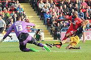 Cambridge United defender Mark Roberts gets back to deny York City forward Emile Sinclair during the Sky Bet League 2 match between York City and Cambridge United at Bootham Crescent, York, England on 3 October 2015. Photo by Simon Davies.
