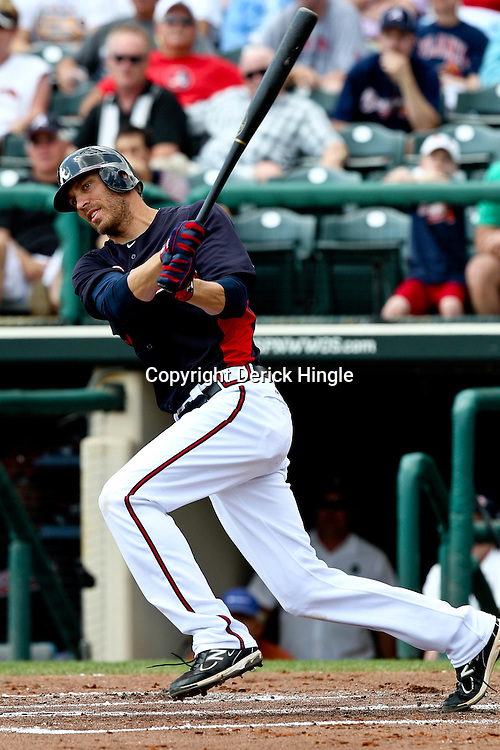 March 16, 2011; Lake Buena Vista, FL, USA; Atlanta Braves center fielder Joe Mather (4) during a spring training exhibition game against the Boston Red Sox at the Disney Wide World of Sports complex.  Mandatory Credit: Derick E. Hingle