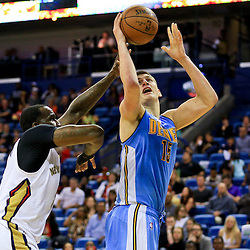 Mar 31, 2016; New Orleans, LA, USA; Denver Nuggets center Nikola Jokic (15) is defended by New Orleans Pelicans center Kendrick Perkins (5) during the second quarter of a game at the Smoothie King Center. Mandatory Credit: Derick E. Hingle-USA TODAY Sports