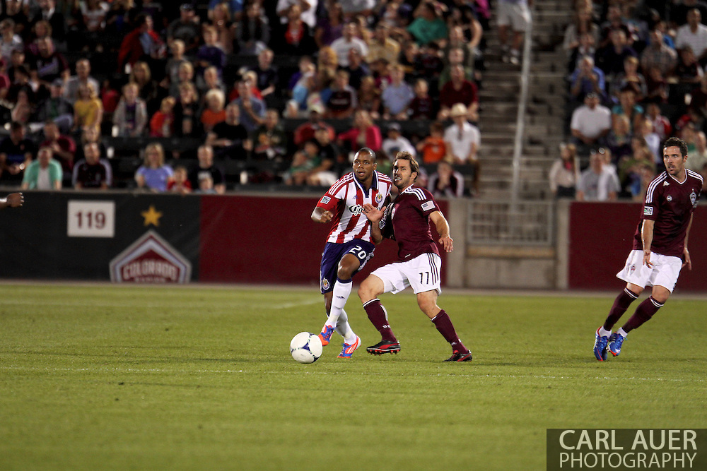 August 18th, 2012: Chivas USA forward Tristan Bowen (20) pushes past Colorado Rapids midfielder Brian Mullan (11) in the second half at Dick's Sporting Goods Park