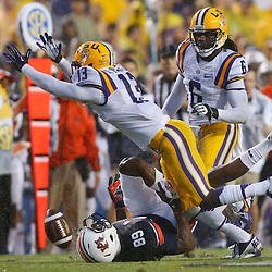 Sep 21, 2013; Baton Rouge, LA, USA; Auburn Tigers wide receiver Jaylon Denson (89) injures his knee on a play as he is defended by LSU Tigers cornerback Dwayne Thomas (13) and safety Craig Loston (6) during a game at Tiger Stadium. Mandatory Credit: Derick E. Hingle-USA TODAY Sports