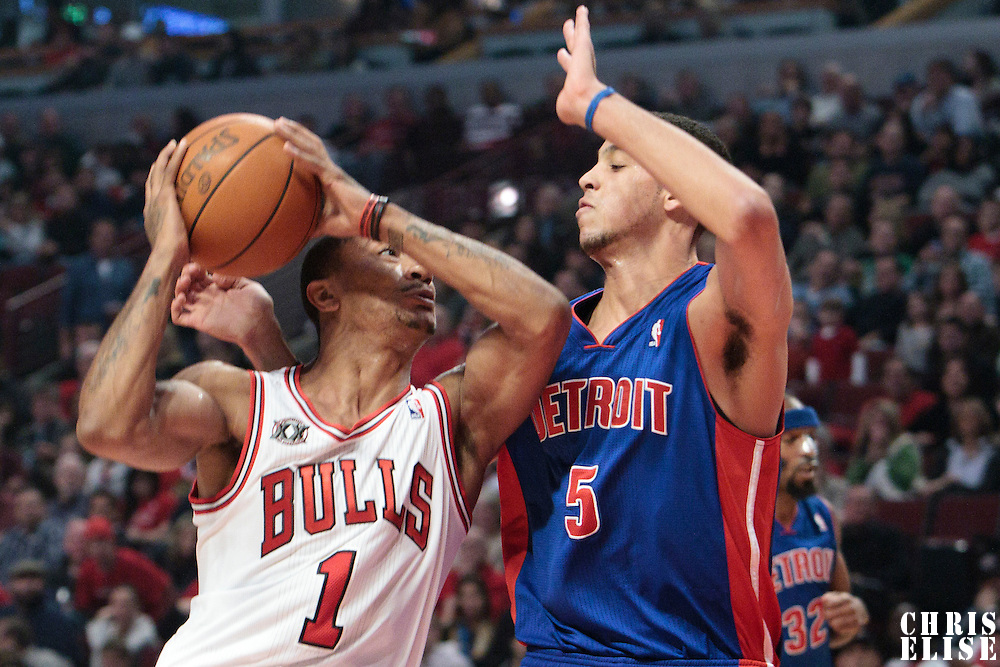 30 October 2010: Chicago Bulls Derrick Rose goes to the basket against Detroit Pistons Austin Daye during the Chicago Bulls 101-91 victory over the Detroit Pistons at the United Center, in Chicago, Illinois, USA.