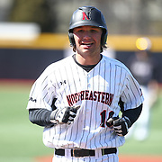Mike Piscopo #19 of the Northeastern Huskies on the field during the game at Friedman Diamond on March 16, 2014 in Brookline, Massachusetts. (Photo by Elan Kawesch)