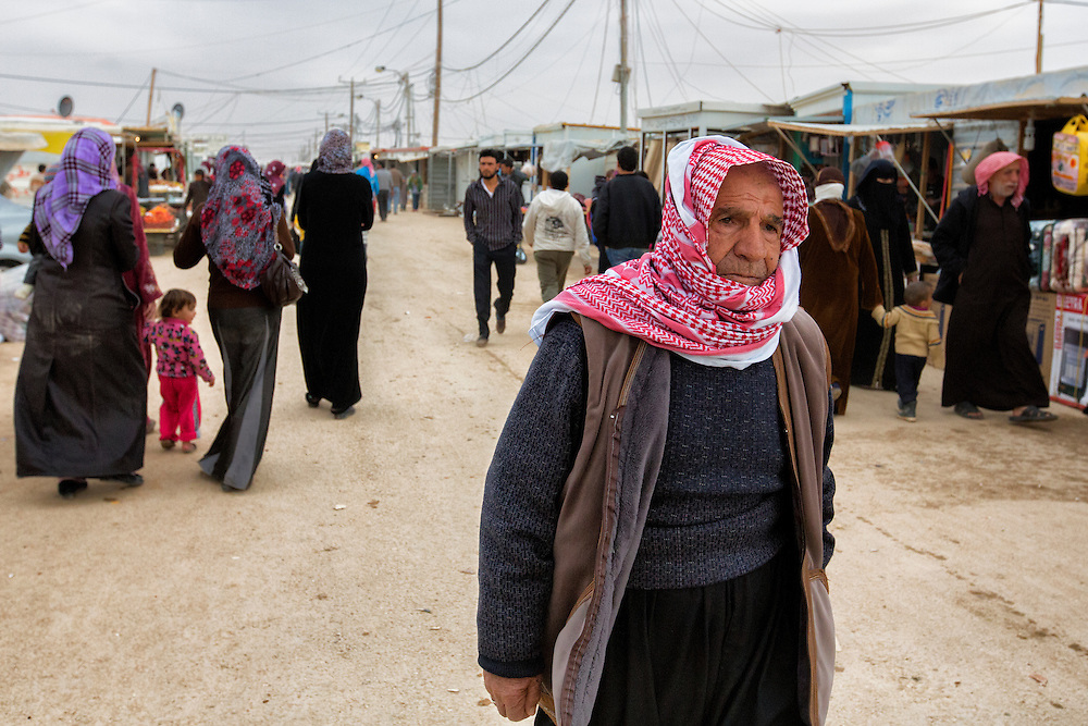 "The so-called ""Champs-Élysées"" is the main street that runs through the camp from north to south. Refugees facetiously named it after the elegant Parisian avenue. Jan. 27, 2014. Zaatari Camp, Jordan. (Photo by Gabriel Romero/Alexia Foundation ©2014)"
