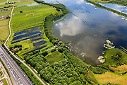 Nederland, Noord-Holland, Gemeente Naarden, 14-06-2012; Natuurgebied Naardermeer en het verkeer van de A1 (links beneden)..Nature reserve Naardermeer (lake) provides a home for rare animals and birds, along the roadway A1..luchtfoto (toeslag), aerial photo (additional fee required).foto/photo Siebe Swart
