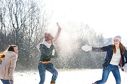 Teenage Girls in Snowball Fight