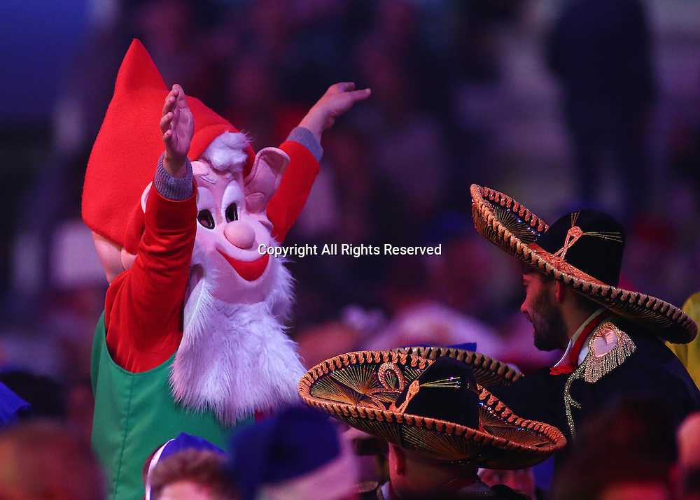 23.12.2016. Alexandra Palace, London, England. William Hill PDC World Darts Championship. A fan dressed as a Gnome attempts to get the crowd singing, as they prepare for the match between Mervyn King and Michael Smith