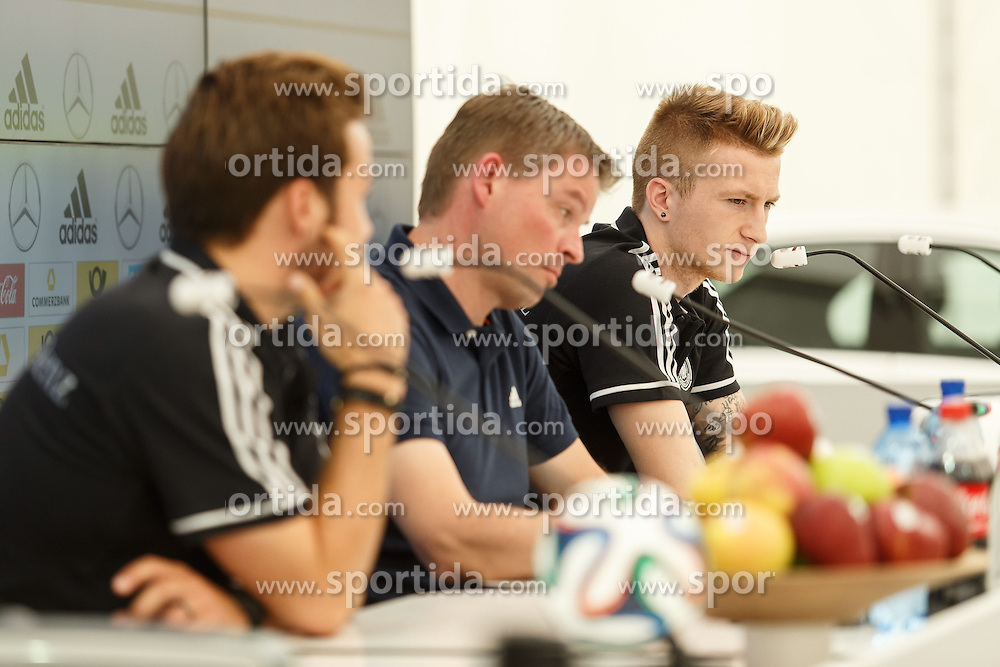 24.05.2014, Sportplatz, St. Martin Passeiertal, ITA, FIFA WM, Vorbereitung Deutschland, im Bild Marco Reus (Deutschland), im Vordergrund Mario Goetze (Deutschland) und Pressesprecher Jens Grittner // during Trainingscamp of Team Germany for Preparation of the FIFA Worldcup Brasil 2014 at the Sportplatz in St. Martin Passeiertal, Italy on 2014/05/24. EXPA Pictures &copy; 2014, PhotoCredit: EXPA/ Eibner-Pressefoto/ Neis<br /> <br /> *****ATTENTION - OUT of GER*****