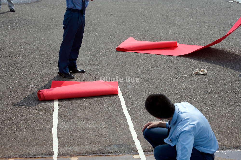 red carpet being rolled up