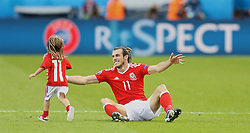 PARIS, FRANCE - Saturday, June 25, 2016: Wales' Gareth Bale and his daughter Alba Violet after the 1-0 victory over Northern Ireland during the Round of 16 UEFA Euro 2016 Championship match at the Parc des Princes. (Pic by David Rawcliffe/Propaganda)