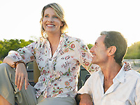 Portrait of couple outdoors man looking at woman smiling