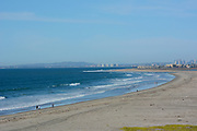People at Imperial Beach Near the California Mexico border Looking North Towards San Diego