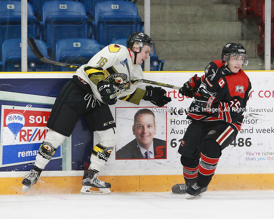 TRENTON, ON  - MAY 5,  2017: Canadian Junior Hockey League, Central Canadian Jr. &quot;A&quot; Championship. The Dudley Hewitt Cup. Game 7 between Georgetown Raiders and the Powassan Voodoos.  Rhys Brown #16 of the Powassan Voodoos holds the stick of Luke Beamish #55 of the Georgetown Raiders during the second period.<br /> (Photo by Tim Bates / OJHL Images)