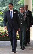 President Obama, General David Petraeus, and Vice President Biden walk to the Rose Garden before President Barack Obama announces the appointment of General David Petraeus to be commander of Western Forces in Afghanistan. Photograph by Dennis Brack
