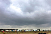 © Licensed to London News Pictures. 29/11/2013. Southwold, UK Rain clouds form over deserted beach huts in Southwold, Suffolk today, 29 November 2013. Photo credit : Stephen Simpson/LNP