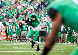 Oct 24, 2015; Huntington, WV, USA; Marshall Thundering Herd quarterback Chase Litton rolls out for a pass against the North Texas Mean Green during the first quarter at Joan C. Edwards Stadium. Mandatory Credit: Ben Queen-USA TODAY Sports