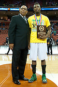 Derrick Smith (24) of Dallas Madison receives the UIL 3A tournament MVP after defeating Houston Yates during the UIL 3A state championship game at the Frank Erwin Center in Austin on Saturday, March 9, 2013. (Cooper Neill/The Dallas Morning News)